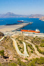 Large tankers in a port next to a mountain Royalty Free Stock Photo