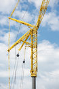 Large telescopic crane against cloudy sky yellow Stock Images