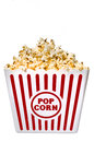 Large tub of delicious buttery popcorn vertical shot a and that s isolated on a white background Stock Photography