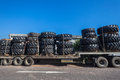 Large tyres truck load new tires on trailer for heavy machines in industries in the economy Royalty Free Stock Images