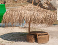 Large umbrella thatched on the sandy beach Royalty Free Stock Image
