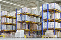 Large warehouse with lots of tall shelves packed containers Royalty Free Stock Photo