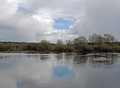 Large water river birch breeze willow on the shore cloudy sky reflection
