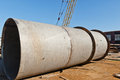 Large welded pipe lies at the base of the metal Royalty Free Stock Photo