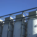 Large white vats exterior against blue sky Stock Image