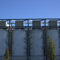 Large white vats exterior against blue sky Royalty Free Stock Images