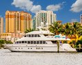 White Yacht by Condo Towers Royalty Free Stock Photo