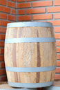 Large wine barrels on red brick wall Stock Image