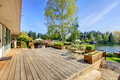 Large wood deck with lake and spring landscape. Royalty Free Stock Photo