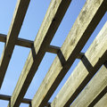 Large wooden beams and blue sky Stock Photos