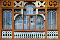 Large wooden window composed of hundreds of small frames made in disrepair Royalty Free Stock Photo
