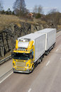 Large yellow and white lorry Stock Images