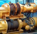Large yellow winch with steel cable two rusting winches rolled up cables Royalty Free Stock Photo