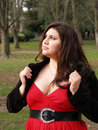 Large young woman in red dress outdoors Royalty Free Stock Image