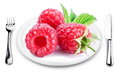 Larger image of raspberries on a plate. Royalty Free Stock Image