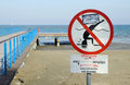 Larnaca Phinikoudes beach with red no jumping warning sign,Cyprus Royalty Free Stock Photo