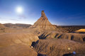 Las bardenas reales desertic landscape at night, moon shine over the horizon. Royalty Free Stock Photo