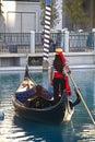 Unidentified people take gondola ride at Venetian Resort hotel and casino Royalty Free Stock Photo