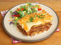 Lasagna al forno dinner beef served with salad Stock Photos
