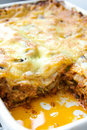 Lasagna bolognese in a square white ceramic tray close up Royalty Free Stock Image