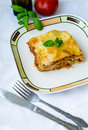 Lasagna piece of bolognese on a white plate Royalty Free Stock Image