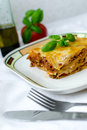 Lasagna piece of bolognese on a white plate Royalty Free Stock Photos