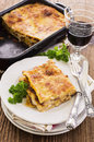 Lasagne with ground meat as closeup on a white plate Royalty Free Stock Photos