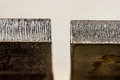 Laser cut edge difference between half inch thick hot rolled ste macro photograph of steel and pickled and oiled Royalty Free Stock Photo