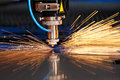 Laser cutting of metal sheet with sparks Royalty Free Stock Photo