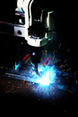Laser cutting of metal sheet with sparks machine Royalty Free Stock Photo