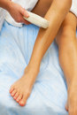 Laser epilation hair removal on ladies legs Stock Images