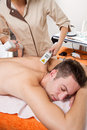 Laser epilation young man receiving on beauty center Royalty Free Stock Images