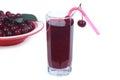 Lass of cherry juice isolated and plenty ripe cherries Stock Images