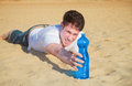 Last effort to water thirsty man makes the reach among sand Stock Photos