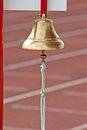 Last lap a bell announcing the of a race Royalty Free Stock Photo