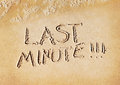 Last minute word written on beach sand Stock Photos