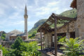 The last traces of war building destroyed by in mostar bosnia and herzegovina in background is a mosque Stock Photography