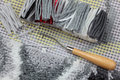 Latch hook handmade carpet weaving preparation to rug canvas cut yarns Stock Images