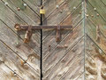 Latch and lock on old weathered wood gate Stock Photography