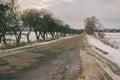 Autumn landscape with remote empty road to Velyka Pavlivka village in Poltavskaya oblast, Ukraine Royalty Free Stock Photo
