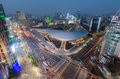 Late night traffic blurs past dongdaemun design plaza seoul city Stock Image