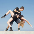 Late teenagers dancing outdoors Royalty Free Stock Photos