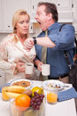 Late for Work Stressed Couple in Kitchen Royalty Free Stock Images