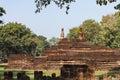 Laterite Stupa Foundation with Buddha Statues at Wat Pra Khaeo Kamphaeng Phet Province, Thailand Royalty Free Stock Photo