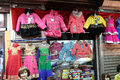 Latest Indian Childrens clothing in front of a retail cloth shop in Kolkata Royalty Free Stock Photo