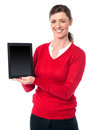 The latest touch pad device is out for sale saleswoman displaying newly launched tablet Stock Photo