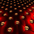 Latex chesterfield upholstery with golden skulls Royalty Free Stock Photo