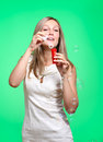 Lather cheerful girl inflates soap bubbles on a green background Stock Photos