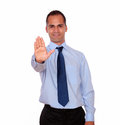 Latin adult man giving the high portrait of a against white background Stock Photo