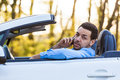 Latin american driver making a phone call while driving young Royalty Free Stock Photo